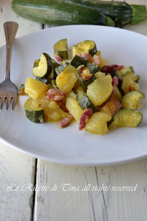 Zucchini and potatoes in pan