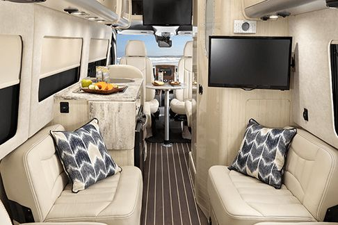 Embrace the call of the open road with the luxury, comfort and sophistication of the Interstate Lounge EXT touring coach from Airstream.