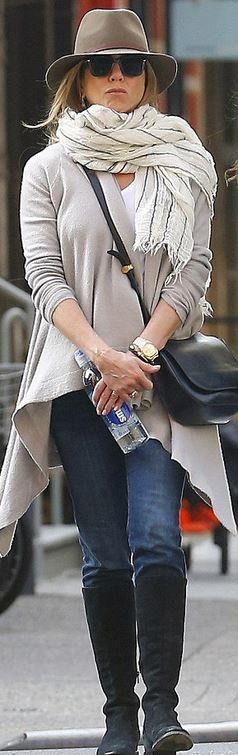 Who made  Jennifer Aniston's gold watch, black handbag, and brown hat?