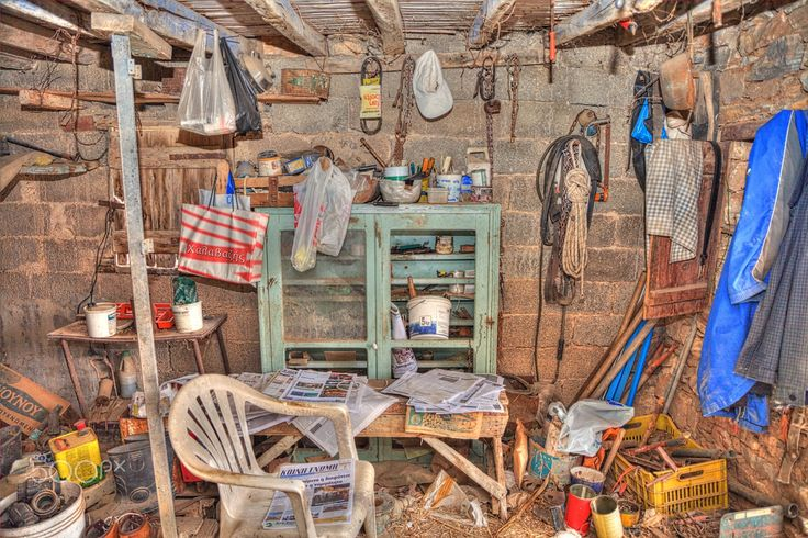 Cluttered Space - Abandoned and very messy dirty  barn room. The area reminded me of a scene from a video game .