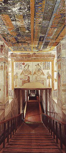 Ramses VI Tomb (KV9) adjacent to tomb of King Tutankhamen. A staircase leads down to the entrance where the lintel is decorated w/the traditional  scene of Isis  Nephthys kneeling at either side of the sun disc.