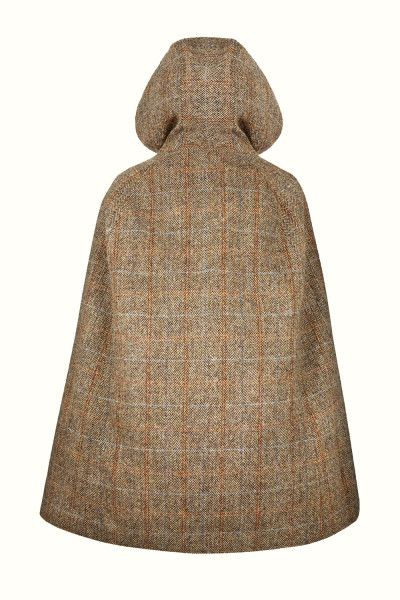 Sienna Mix Hooded  - Luxuriously crafted with handwoven Harris Tweed, this golden hued cape is a modern twist on a classic design.With its large, slouched hood, this cape will be the perfect choice for outerwear all year around.