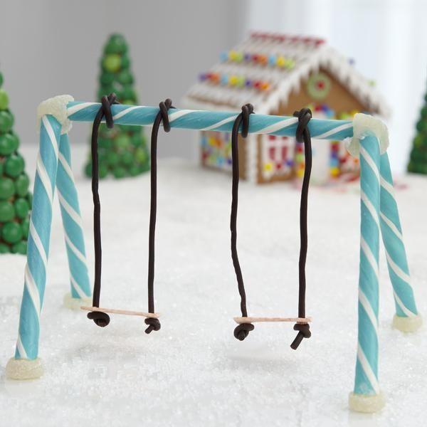 Make play equipment for the back yard of your Wilton gingerbread house! Candy sticks, spice drops, stick gum and string licorice make a sweet swing set.
