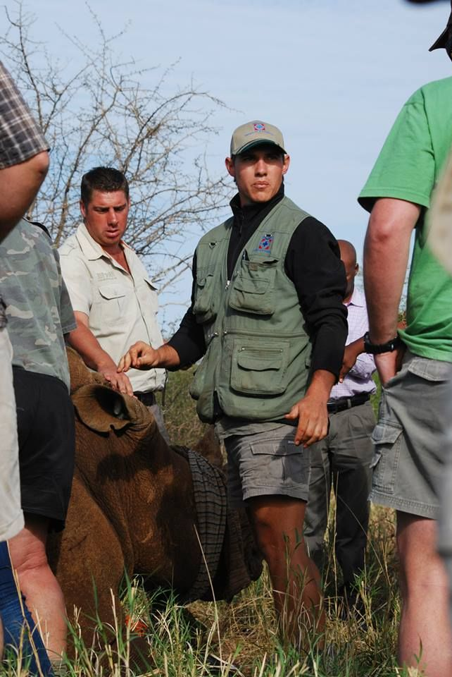 The wildlife vet just explaining what he is going to be doing with the rhino.