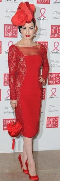 Who made Dita Von Teese's red lace sleeve dress?