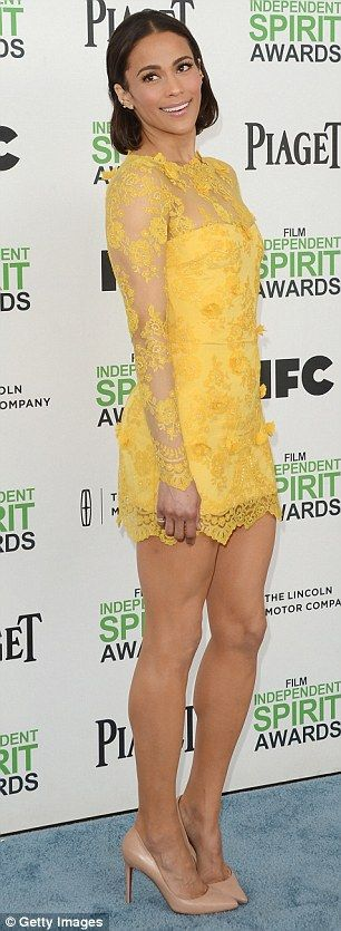 Elegant and stylish: Her bright and cheery sheer mini lace dress that showed off her lean legs and exquisite figure