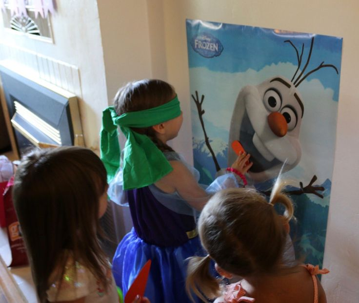 Pin the nose on Olaf. An easy party game for a Frozen Themed Birthday Party.