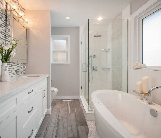 The wall color is Stonington Gray HC-170 by Benjamin Moore. The ceiling and trim paint are Chantilly Lace OC-65 by Benjamin Moore