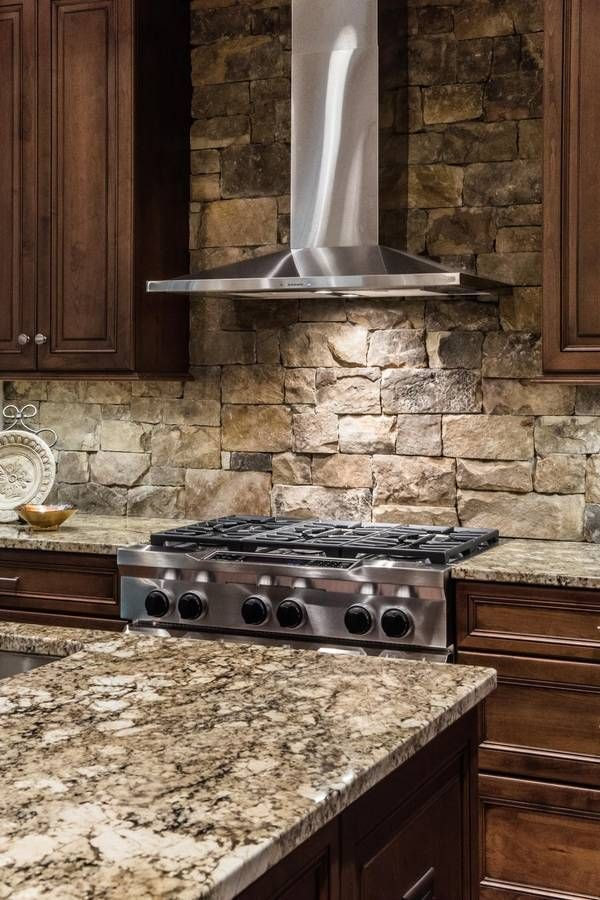 A stone backsplash can create a magnificent accent in the kitchen and  complement the rustic decor