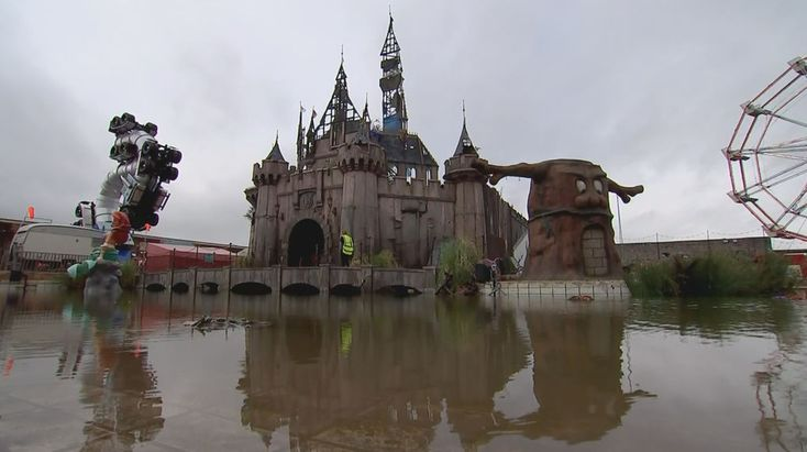 Dismaland castle- Clandestine street artist Banksy opens a theme park like no other. Inside a derelict lido in Weston-super-Mare, Dismaland features migrant boats, a dead princess and Banksy's trademark dark humour.