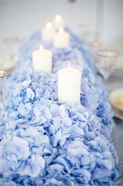 Featured Photographer: Jay Anderson Photography; Elegant blue floral tablescape wedding reception centerpiece with romantic white candles