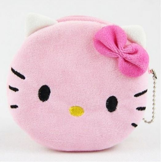 Introducing Hello Kitty Plush Coin Purse! Soft and just perfect to put all your coins, keys, jewelry, or business cards and notes, you'll be sure to use this little pocket for everything. It is super
