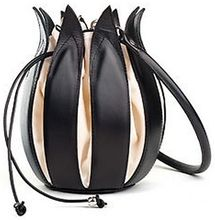 An unusual designer handbag 'Classic Tulip' from by-Lin in a shape of a tulip flower made with black leather and cream canvas is a perfect accessory and a beautiful gift.