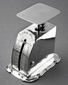 """A rare Victorian silver postal scale, in full working order. The scale is intended for measuring postal items, so that the correct postage could be applied. This scale would have been used in a wealthy household, not a Post Office. The front is engraved """"Postal Scale"""" on top, on the side """"Postal Union Rates 2 1/2 d for each 1/2 ounce."""" To the left is engraved """"English Rates"""" above measuring scale from 1d - 4d in 1/2 increments. To the right are 2 measures, 1 marked """"LB"""" for ...."""