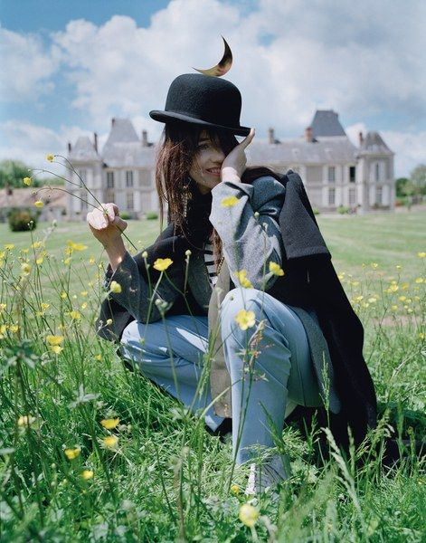 Céline cape; Charlotte Gainsbourg for Current/Elliott jacket and shirt; Brooks Brothers pajama pants; Adidas Originals shoes. Christys' Hats London hat; Céline earring; Prada scarf; Sacai pin (throughout).
