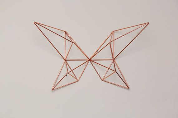 Geometric beauty at its finest. This himmeli butterfly sculpture consists of 4 various geometric wings, adjoined at one focal place in the