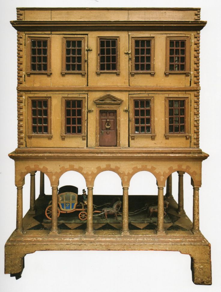 Issue 11 (Nov 2011) p2 - Dolls' Houses Past & Present.  See the little carriage under the house.  I would love that!
