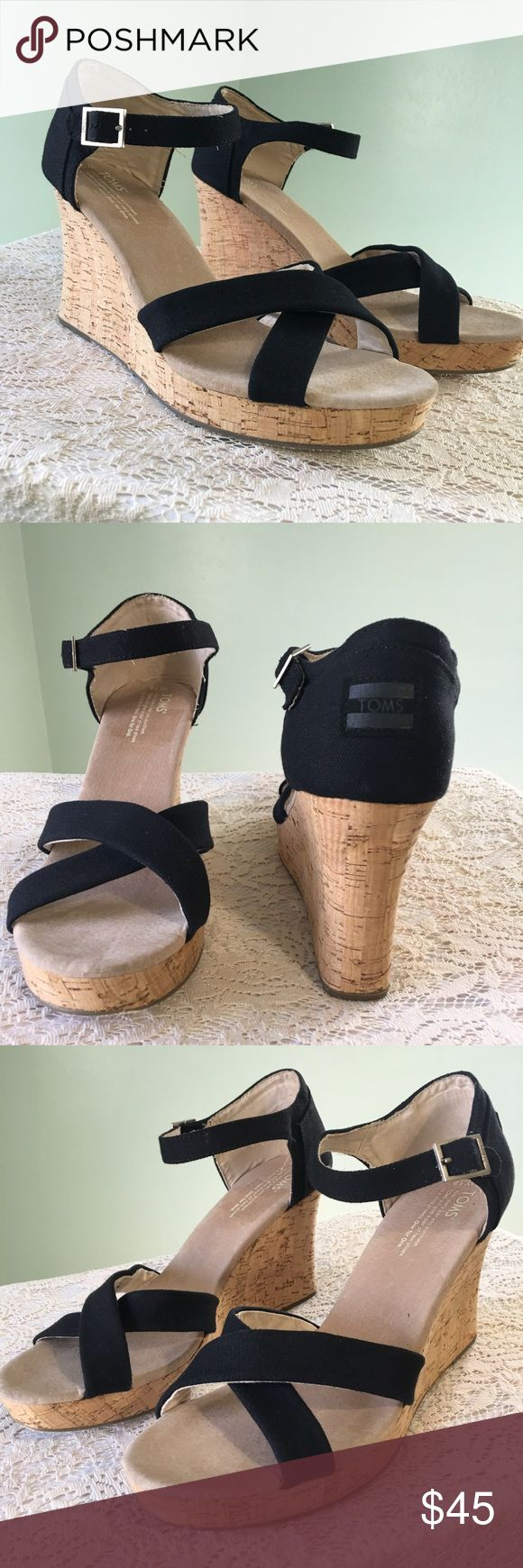Toms Black Wedge Platform Sandals Size 12 TOMS women's classic black ankle ankle strap cork wedge sandals Condition: new without tags; (Has some writing on the bottom of right sole with silver sharpie) Size 12  Color: Black with cork wedge heel Ankle strap closure Perfect for dresses or jeans. Toms Shoes Sandals