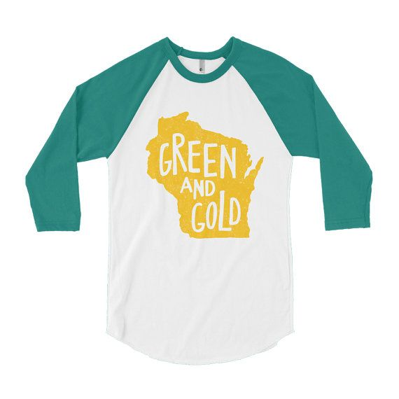 Calling all Packers fans — this Green and Gold raglan tee is perfect for you or works as a great gift for any other Packer-backer. This tee is American Apparel unisex poly-cotton 3/4 sleeve raglan shirt. It has everything you love about the fit, feel and look of a classic baseball raglan, with a combed cotton blend that makes it super soft, comfortable and lightweight. The fit is unisex, so for men it is true-to-size and for women its slightly looser! Wash warm and tumble dry on low. Ink…