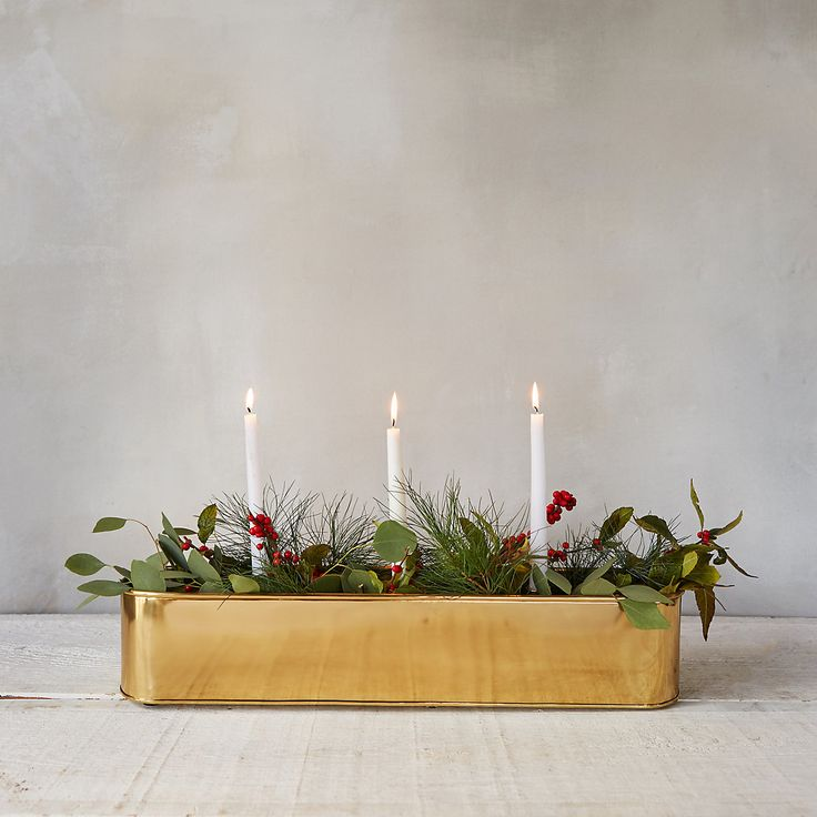 We've updated our favorite table trough to hold a trio of tapers surrounded by plants, adding candlelight to your events and centerpieces. Hand-