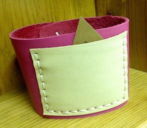 Hand stitched leather coffee cup cozy with handy pocket.  $12 From www.facebook.com/stashbug