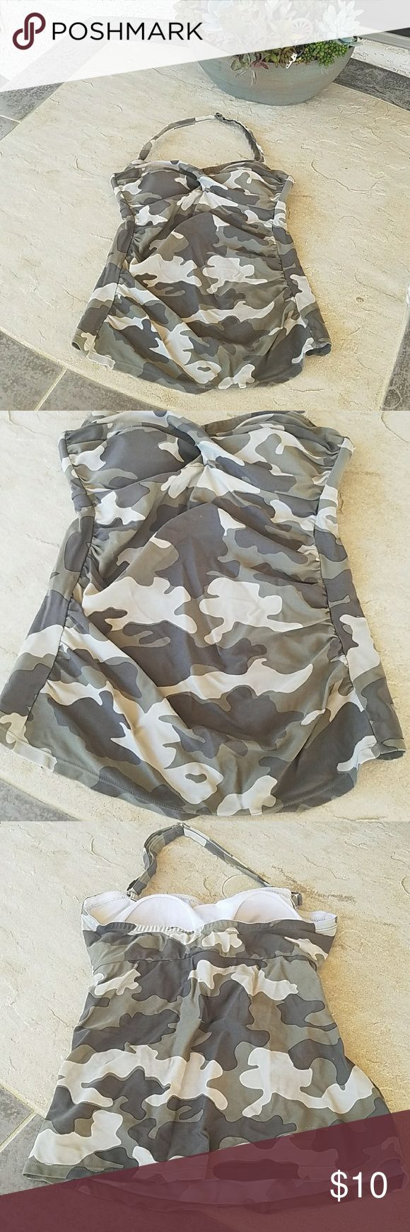 Camo Tankini Halter camouflage tankini. Brand: Venus. Size 6. Fits a full C cup. Rouching sides. Lightly padded. No defects but slight signs of wear. 80% Polyamid, 20% Elasthan. Adjustable strap but is also removable to wear as strapless. Final price unless bundled. Comes from a smoke free home. No trades, no holds, thank you. Venus Swim