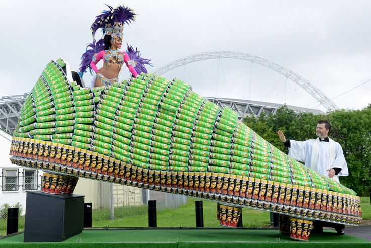 17ft long 'lucky' boot made of 1,500 cans of Pringles blessed by priest