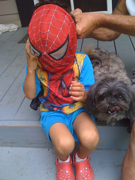 The Real SpiderBoy - being fitted by dad! Good Dad, Great Father!