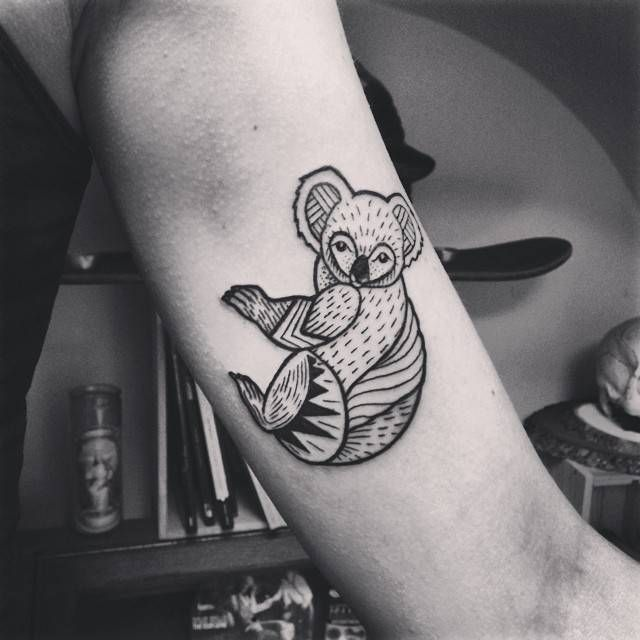 Koala tattoo on the left inner arm.