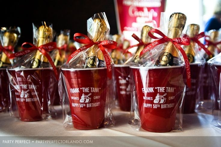 Cool champagne 50th birthday party favors with custom ribbon.  Find cups here:  http://www.cool-party-favors.com/red-solo-style-cups-personalized.html