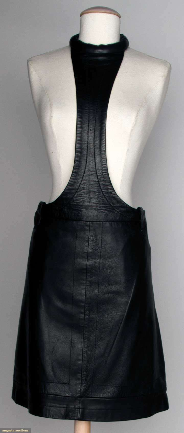 "Pierre Cardin Leather Skirt, C. 1970, Augusta Auctions -- Soft black leather, sits on hip, center column ends in rouleau collar, unlabeled, Low W 31"", Skirt L 19"", excellent. Bought at Pierre Cardin in Paris. Provenance: Mme. Erna de Paz, Argentine & Parisienne socialite & friend of Msr. Cardin."