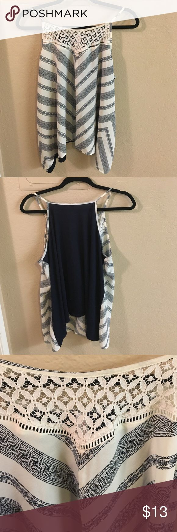 Gorgeous Navy Blue & White shirt. Size XL. This shirt is not for the big breasted ladies! (Learned that the hard way 😞) Navy Blue & White. Brand new, (only tried on) without tags. Very pretty! Xhilaration Tops Tank Tops