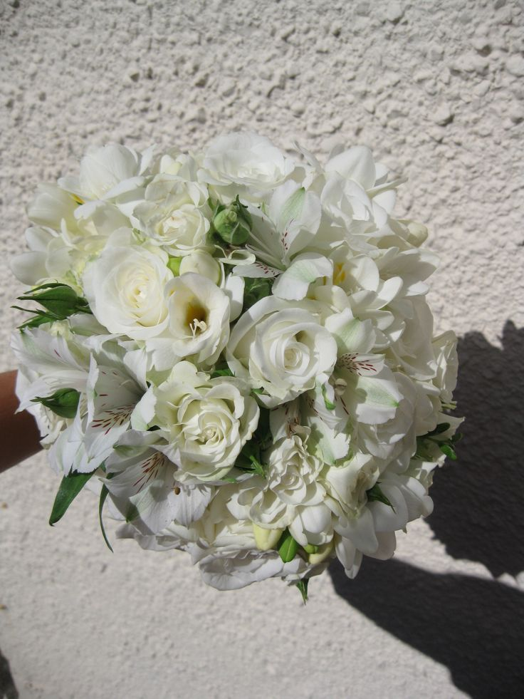Freesia, spray rose, alstromeria and lisianthus hand tied bouquet