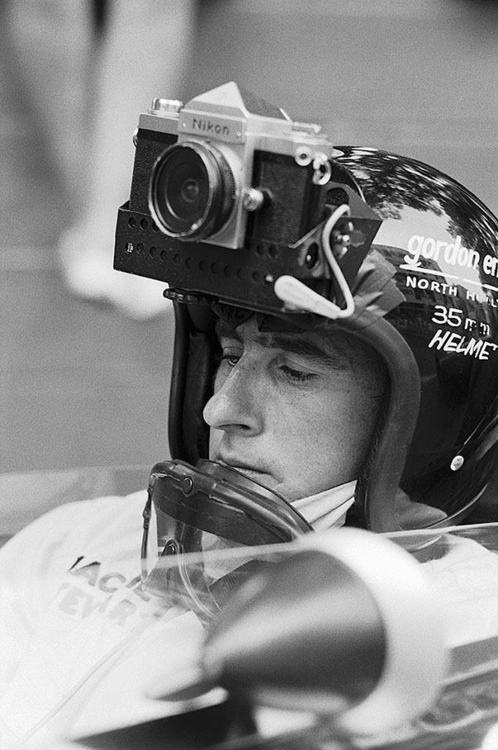"""Jackie Stewart/35mm Helmet/Monaco/1966    """"Monaco GP 1966, Jackie Stewart driving for  Matra was asked by a French photographer to take some images during practice with this Nikon F1 attached to his helmet."""" via"""