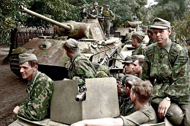Sd.Kfz 251/3 and Panzer V 'Panther' of Kampfgruppe Mühlenkamp: from 5.SS-Pz.Div. 'Wiking' (consisting of SS-Pz.Rgt. 5 and III. Btl. SS-Pz. Grenadier Regt. 'Germania') in Eastern Poland during...