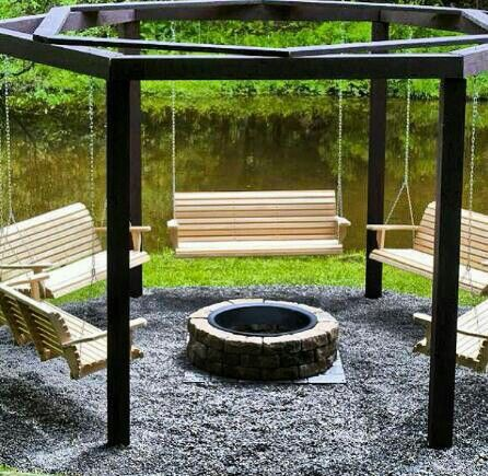 Love this fire pit with swings around it