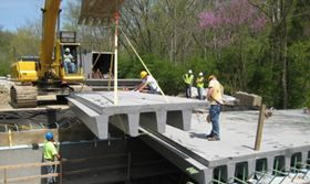 In addition to lighter weight, corrosion resistance, higher strength and lower life cycle costs, FRP technology offers faster installation. Prefabricated FRP panels can be installed quickly, compared to the labour intensive process of erecting formwork, placing rebar, pouring and curing concrete, and removing the formwork needed to construct a cast-in-place bridge. Eliminating the need for heavy equipment, FRP panels are generally placed starting at one abutment with light equipment such as…
