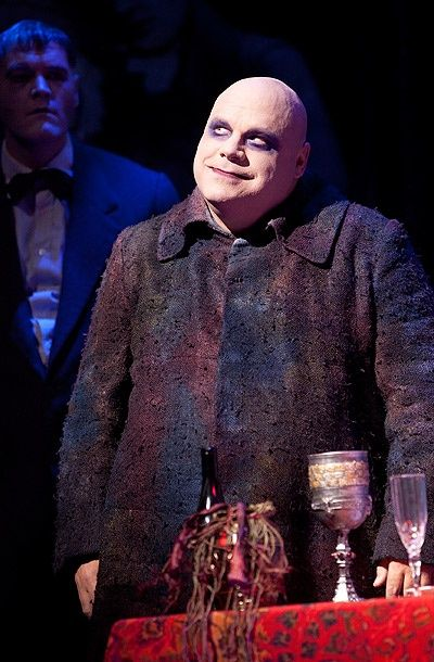 Zachary James as Lurch and Kevin Chamberlin as Uncle Fester in The Addams Family.