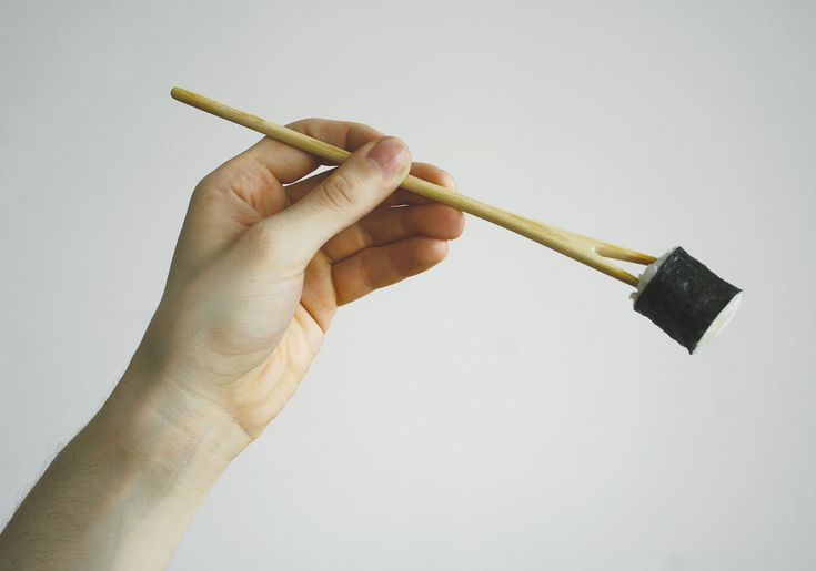 TwoTu Chopsticks - Studio Robot,  Chopsticks and cutlery represent the mix of culture and tradition of The Far East and The West. People who start their adventure with asian cuisine find using chopsticks difficult. This project solves their problem. Inspired by minimalist japanese art, produced with care and respect to the material they are made of - handcrafted pine wood