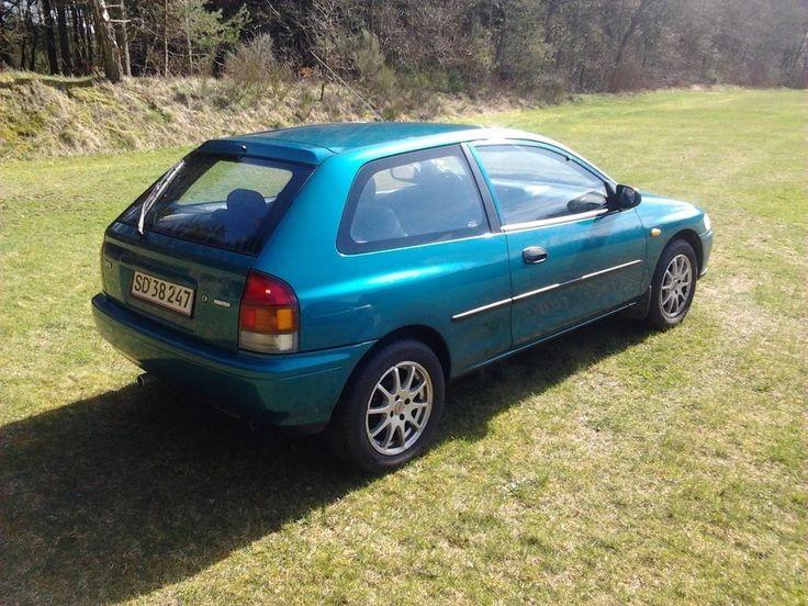 Mazda 323, 1,5 LX aut., aut. 3-dørs, 1997, servostyring, km 196000, grønmetal, nysynet, ABS, airbag, startspærre, Benzin, årg 1997. synet 17/2-17 kører som den skal med mazda´s rigtig gode 1,5 16v motor.og automatgear. alt virker! pæn. lidt bilka buler. ikke rusten i bunden!. har fået malet og rep af skærm kanter bag..  undervogns behandlet. næsten nye støddæmpere i bag. står på alufælge med sommerdæk. vinterdæk på stålfælge medfølger+original hjulkapsler. rigtig fin bil til prisen.