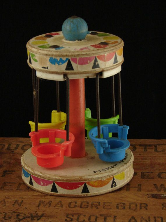 Vintage Toy Fisher Price Chair Ride. It also went to the amusement part my grandparents had. It was fun to twirl the thing so hard that the people would come flying out of the seats.