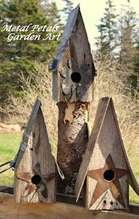 Rustic Birdhouses  Made from old barnboard and an old metal wash bin I found in the woods.    Visit my Facebook page to see more: https://www.facebook.com/pages/Metal-Petals-Garden-Art-Unique-Home-Garden-Decor/223637124324665