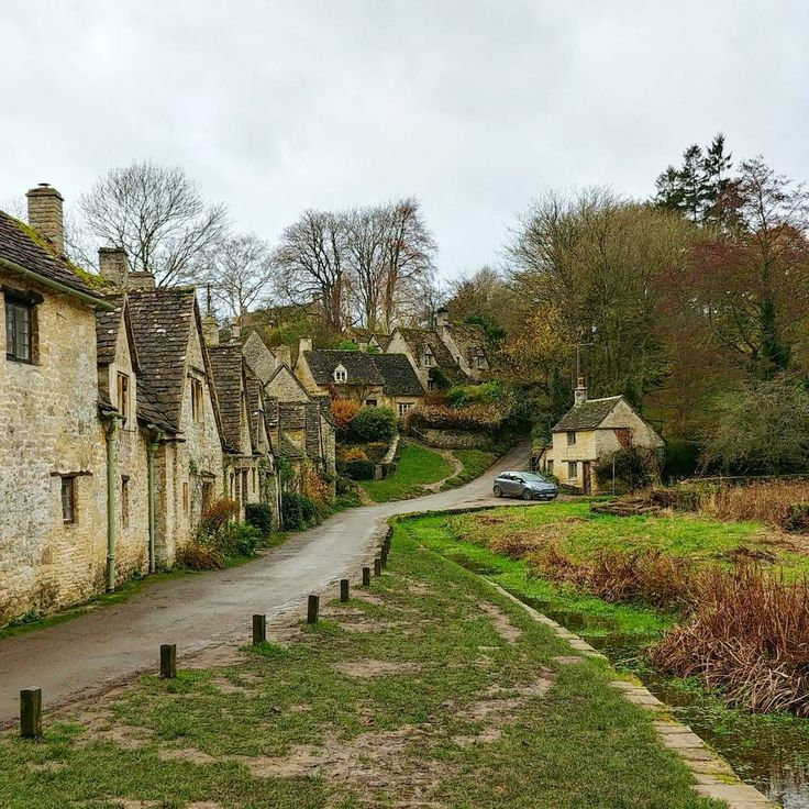 """The Stone Cottages of Arlington Row in Bibury aka """"The most beautiful village in England"""". Fun fact: Arlington Row is depicted on the inside cover of all UK passports"""