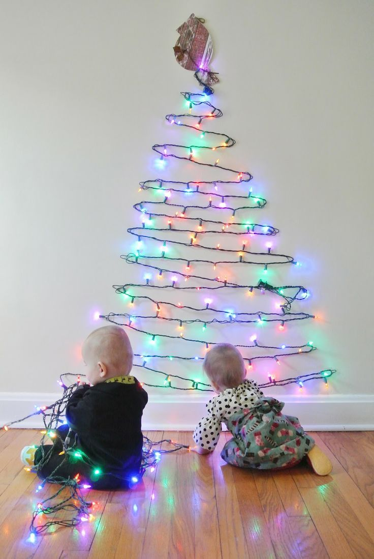 Cute alternative Christmas tree!  Would be great for a small apartment, anywhere where you want to put something Christmas-y but don't want to take up a lot of room or even the front door.