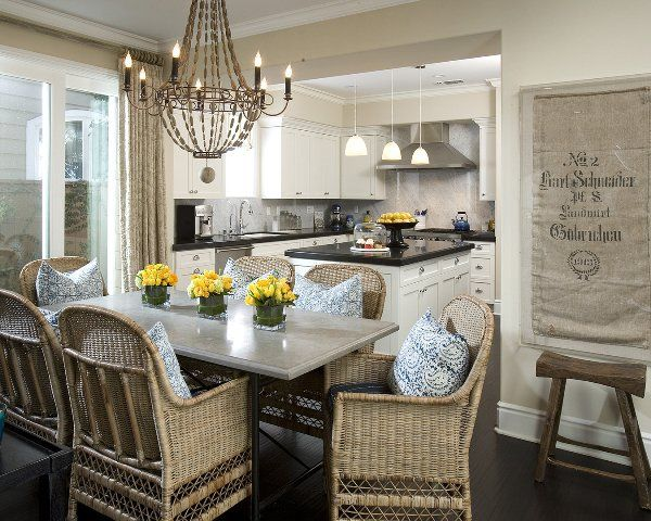 Vallone Design Refined Dining Room With Rustic Wicker Chairs And Arteriors Louis Iron