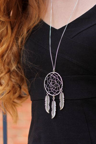 Long necklace with a large wire-wrapped dream catcher pendant.