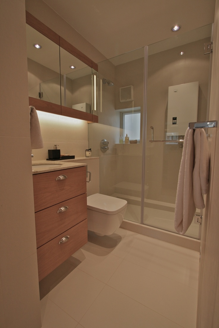 Stone Neutral Shower Room With Oak Cabinetry Wall Hung