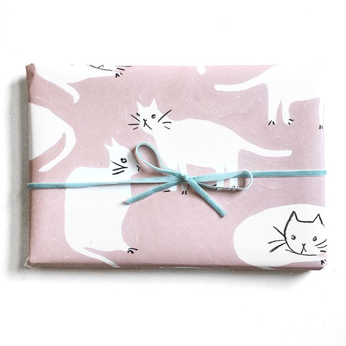It's even more fun to give the cat wrapping paper to your friends who don't like cats.