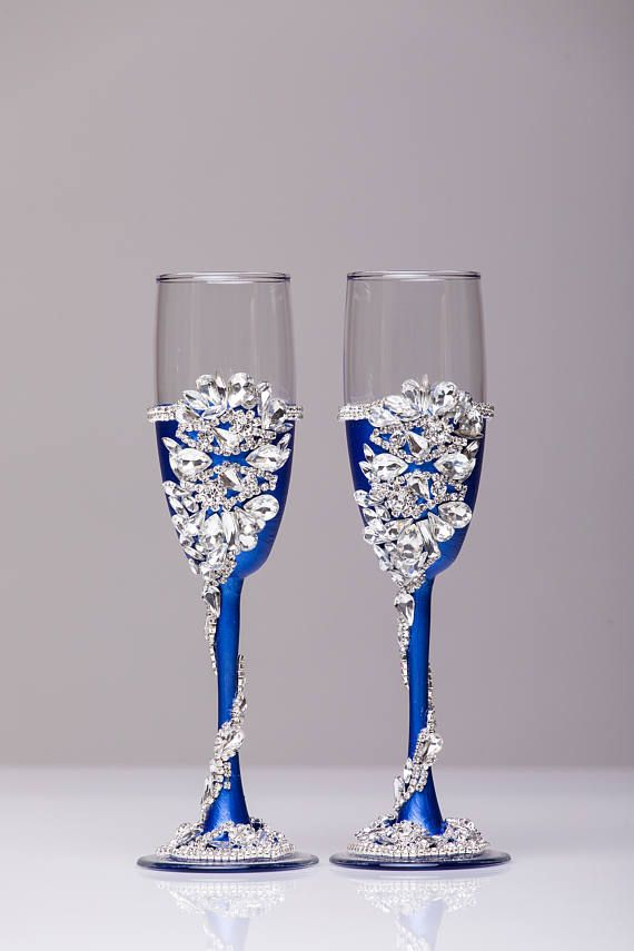 Personalized wedding flutes wedding champagne glasses champagne flutes toasting flutes silver ROYAL BLUE flutes wedding flutes Set of2 For these glasses color - ROYAL BLUE and silver All completely handmade! MEASUREMENTS: -Champagne flutes : Height - 9.2 inch (23.5 sm). Volume – 170ml (6.1 oz) Custom champagne glasses may be created to fit your needs. Your unique wedding colors can be used for this design. Names and date may be painted to customize to your occasion. Glasses will be…
