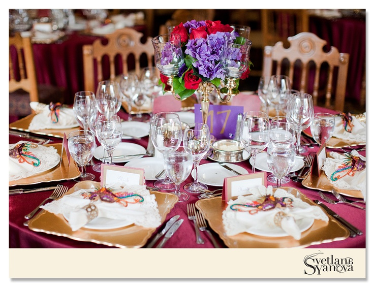 A medieval wedding at the Fairmont Banff Springs; red roses and purple hydrangea in silver candelabras; gold chargers with ivory lace-edged napkins (Photo credit: Svetlana Yanova)